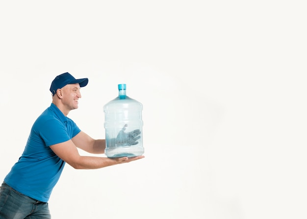 Delivery man holding water bottle and posing