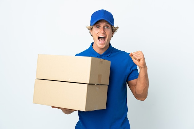 Delivery man isolated celebrating a victory in winner position