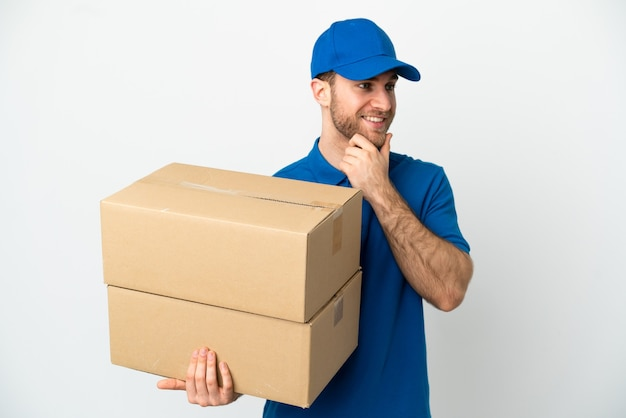 Delivery man isolated looking to the side and smiling