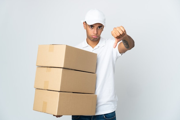 Delivery man isolated showing thumb down with negative expression