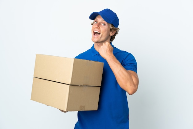 Delivery man isolated white background celebrating a victory