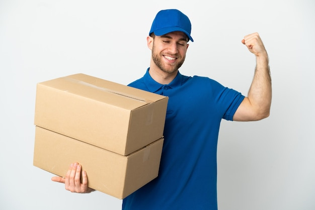 Delivery man over isolated white background doing strong gesture