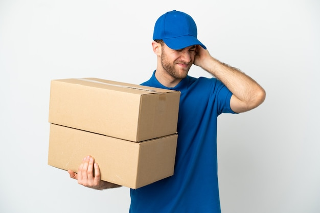 Delivery man over isolated white background frustrated and covering ears