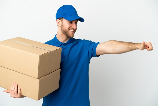 Delivery man over isolated white background giving a thumbs up gesture