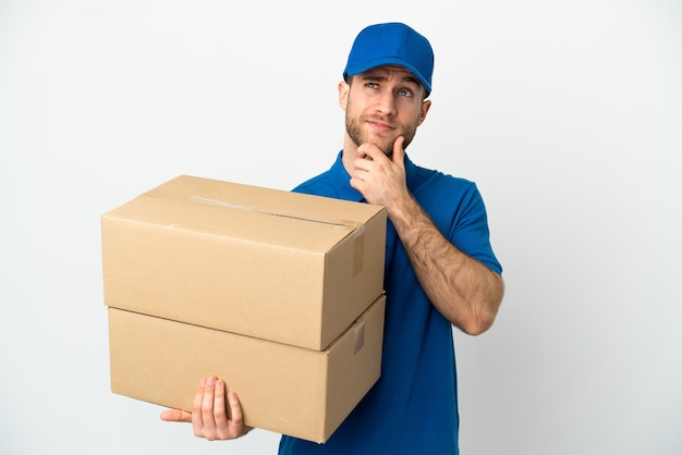 Delivery man over isolated white background and looking up