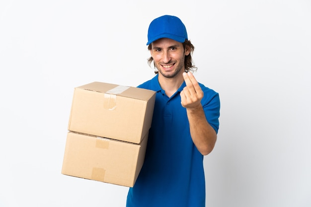 Delivery man isolated on white background making money gesture