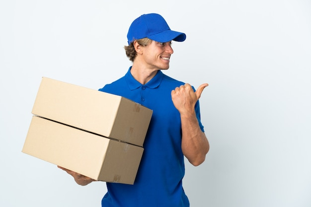 Delivery man isolated white background pointing to the side to present a product