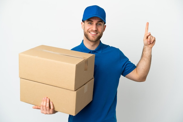 Delivery man over isolated white background pointing up a great idea
