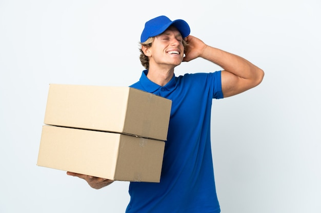 Delivery man over isolated white background smiling a lot
