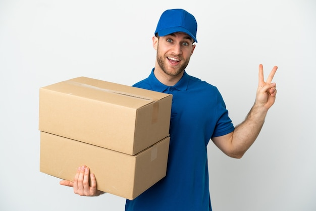 Delivery man isolated white background smiling and showing victory sign