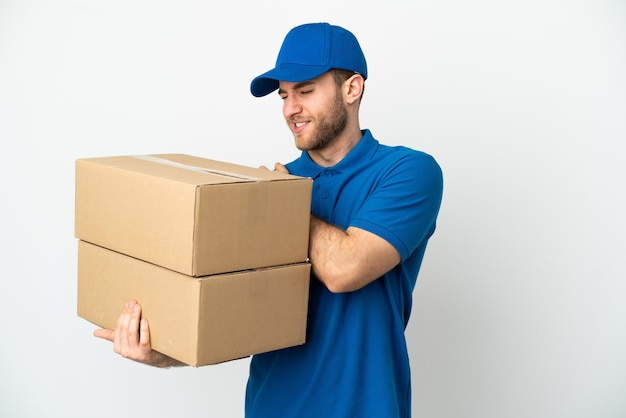 Delivery man over isolated white background suffering from pain in shoulder for having made an effort