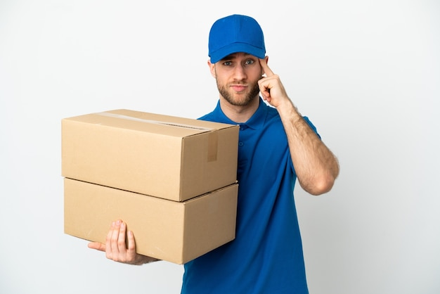 Delivery man over isolated white background thinking an idea