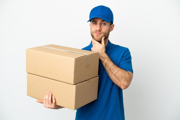Delivery man over isolated white background thinking