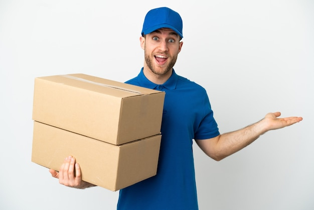 Delivery man over isolated white background with shocked facial expression
