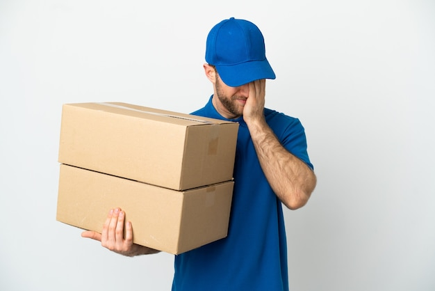 Delivery man over isolated white background with tired and sick expression