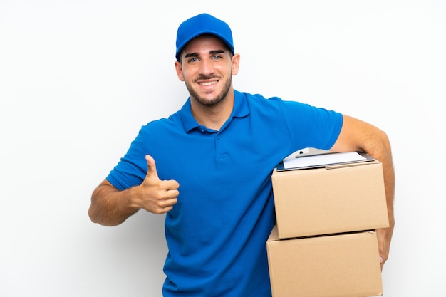 Delivery man over isolated white giving a thumbs up gesture