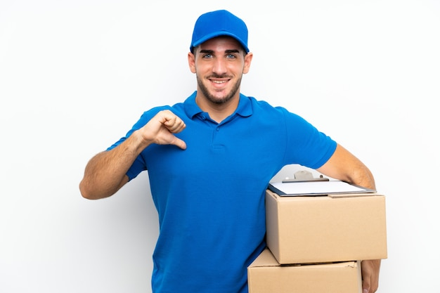 Delivery man over isolated white proud and self-satisfied