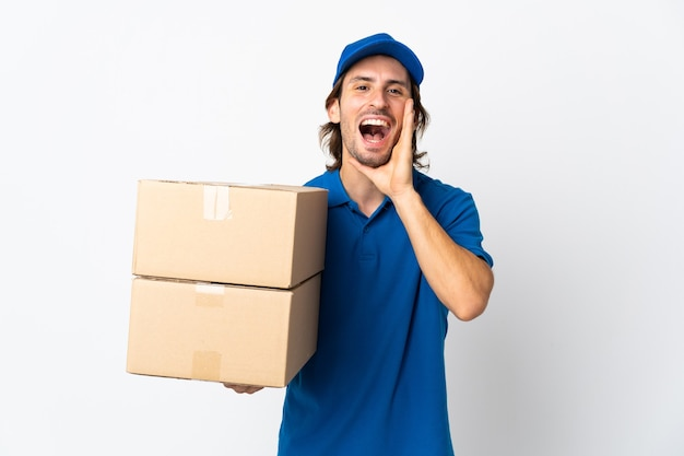 Delivery man isolated on white shouting with mouth wide open
