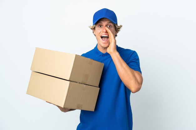 Delivery man over isolated white shouting with mouth wide open