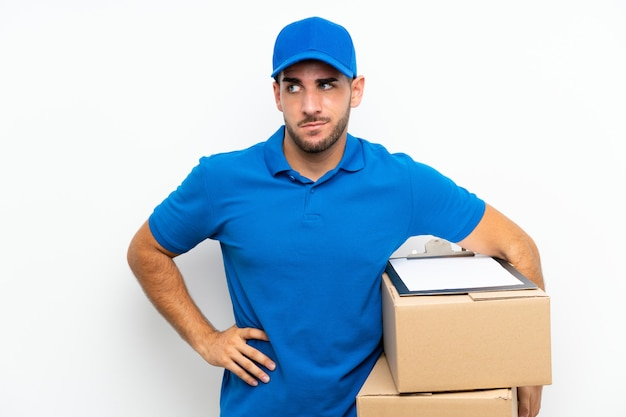 Delivery man over isolated white  thinking an idea