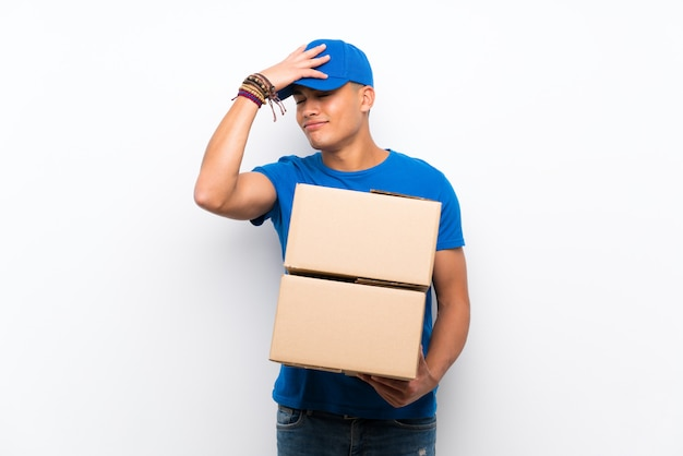 Delivery man over isolated white wall has realized something and intending the solution