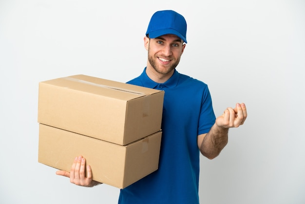 Delivery man over isolated white wall making money gesture