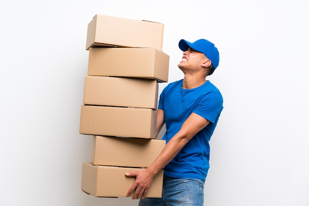 Delivery man over isolated white wall