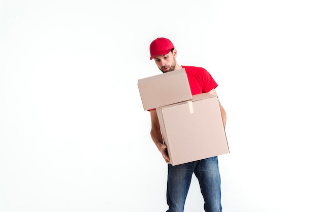 Delivery man leaning over the parcel post boxes