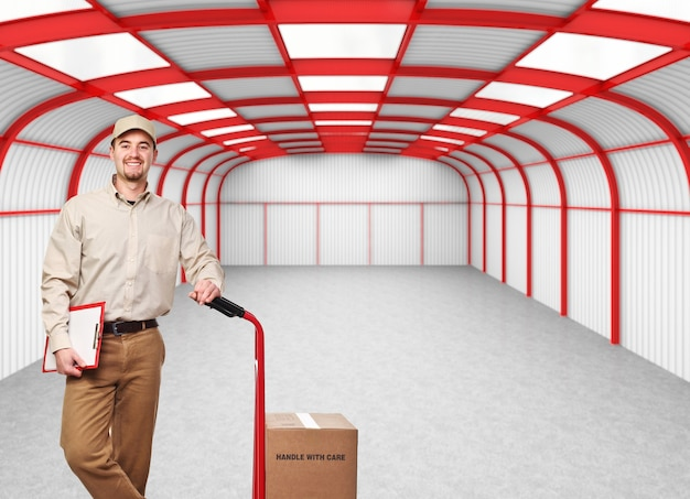 Delivery man portrait and 3d empry warehouse