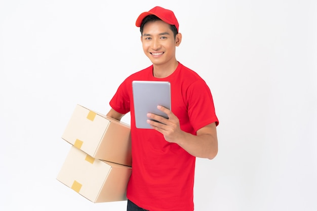 Delivery man in red t-shirt uniform standing with parcel post box