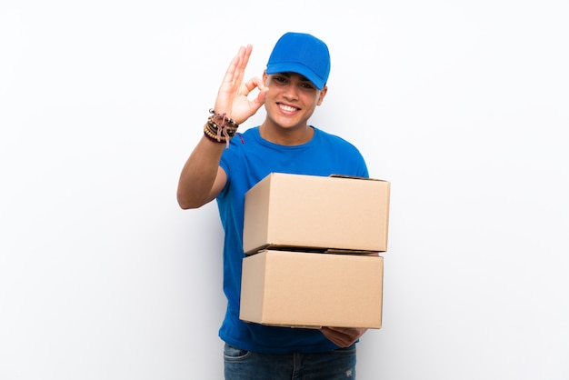 Delivery man showing ok sign with fingers