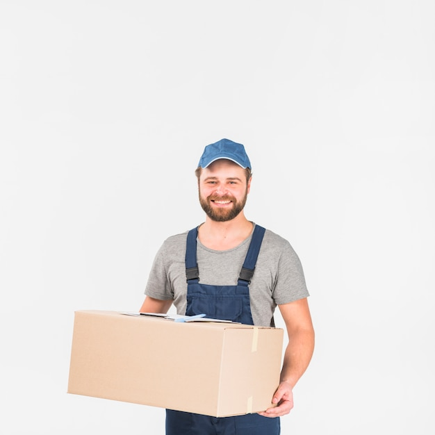 Delivery man standing with big box