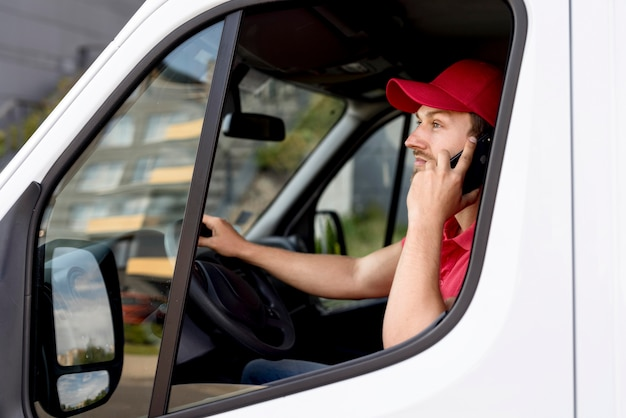 Delivery man talking over phone
