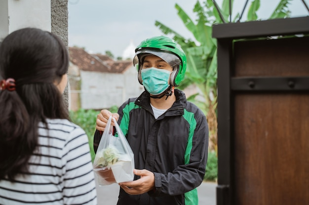 Delivery man wear face mask during delivering food