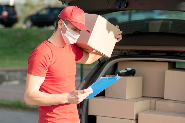 Delivery man wearing mask and hat
