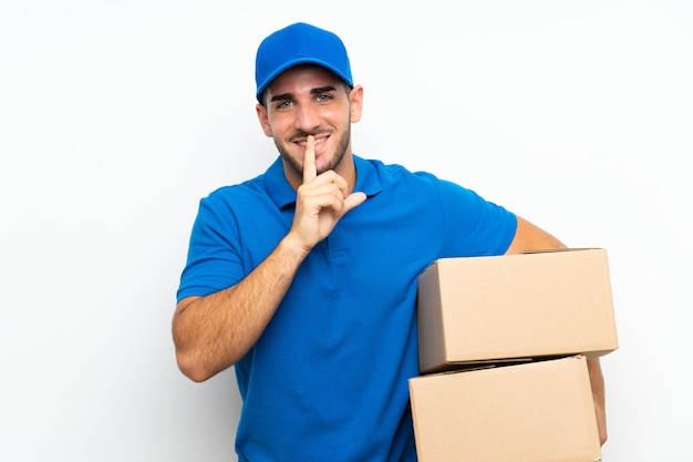 Delivery man  on white  doing silence gesture