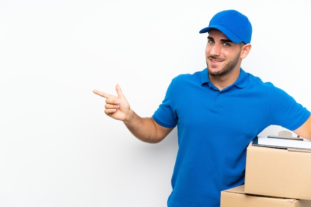 Delivery man  on white  pointing finger to the side