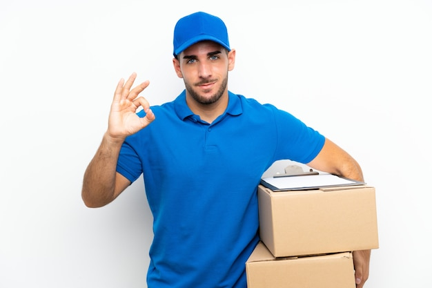 Delivery man  on white  showing an ok sign with fingers