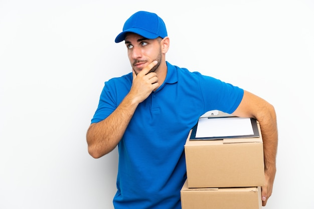 Delivery man  on white  thinking an idea