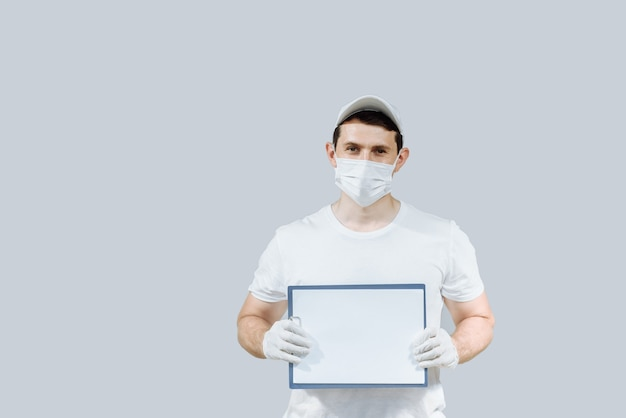 Delivery man in white uniform gloves and mask on an