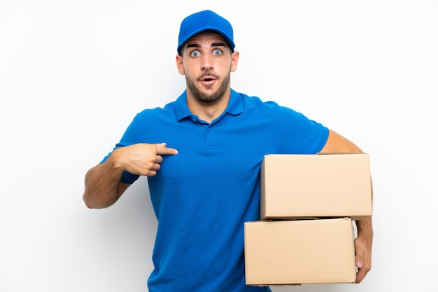 Delivery man  on white  with surprise facial expression