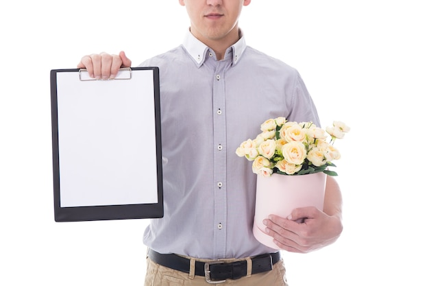 Delivery man with clipboard and cardboard box of flowers isolated on white background