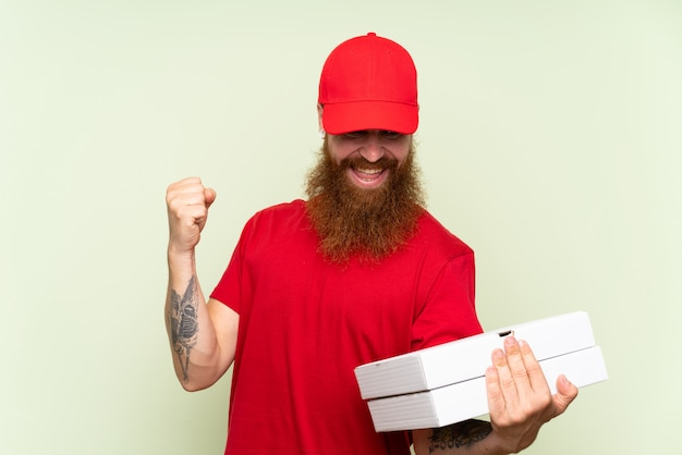 Delivery man with long beard green celebrating a victory