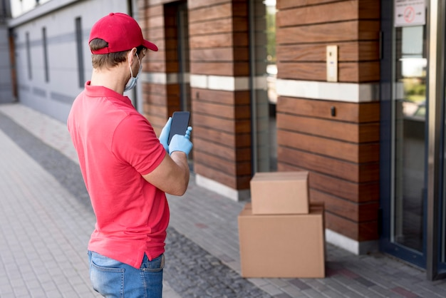 Delivery man with mobile