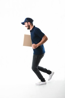 Delivery man with parcel running on white background