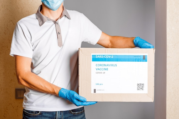 Delivery medical box of vaccines. the courier delivers the vaccine. covid 19 virus Premium Photo