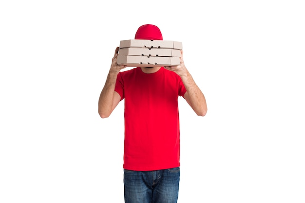 Delivery pizza boy covering his face with boxes medium shot