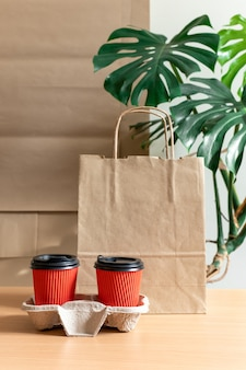 Delivery service cafe packing bag red cup coffee to go take away