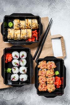 Delivery service japanese food rolls in box