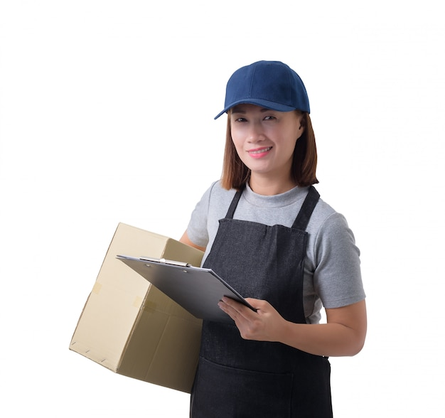 Delivery woman in gray shirt and apron with stack of boxes is carrying parcel and presenting receiving form isolated